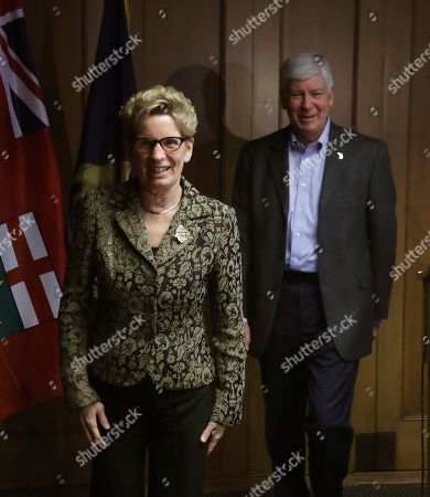 Rick Snyder, Kathleen Wynne Michigan Gov. Rick Snyder and Ontario Premier Kathleen Wynne are seen after their news conference, in Detroit