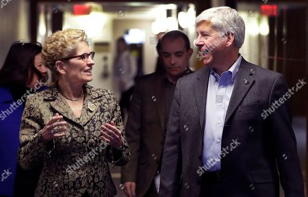 Rick Snyder, Kathleen Wynne Michigan Gov. Rick Snyder and Ontario Premier Kathleen Wynne walk to their joint news conference, in Detroit. Snyder and Wynne stressed that they want their voices heard as President Donald Trump demands a negotiation of trade policies between the United States, Mexico and Canada