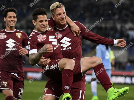 Torino's forward Maxi Lopez (R) jubilates with team mate Juan Iturbe (C) after scoring the 1-1 equalizer during the Italian Serie A soccer match between Lazio and Torino at the Olimpico stadium in Rome, Italy, 13 March 2017.