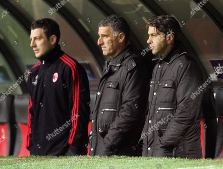 AC Milan assistants Mauro Tassotti and Alessandro Costacurta watch on from the bench