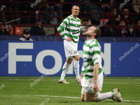 A dejected Kenny Miller and Craig Beattie of Celtic - Ford ad board