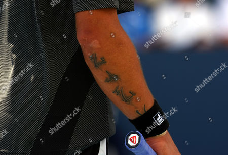 Stock Image of A Tattoo On the Arm of Jarko Tipsarevic of Serbia at the Us Open 2010 United States New York