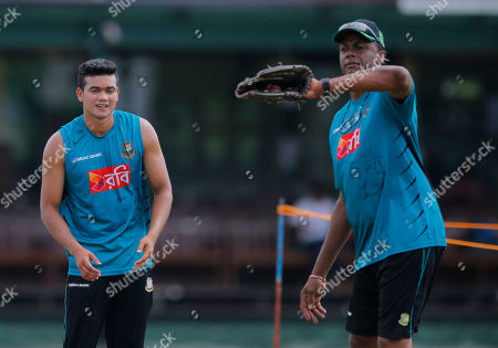 Courtney Walsh, Taskin Ahmed Bangladeshi bowling coach Courtney Walsh, right, attends to bowler Taskin Ahmed during a practice session prior to their test cricket match against Sri Lanka in Colombo, Sri Lanka