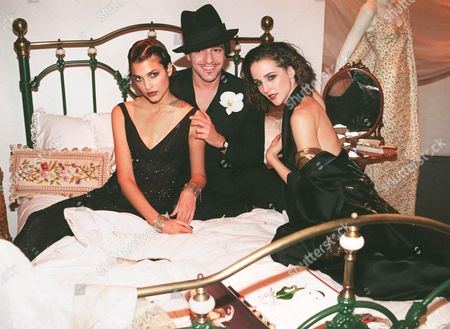 British Fashion Designer John Galliano of Paris Fashion House Dior Poses with Dior Models Teresa Lourenco (l) and Suzanne Alchinger at the Launch of His New Book 'Galliano' by Author Colin Mcdowell 23 October at a Book Launch Party in Harrods Department Store in London Galliano was Voted Fashion Designer of the Year Along with Londoner Alexander Mc Queen at the British Fashion Awards Ceremony in London 22 October United Kingdom London