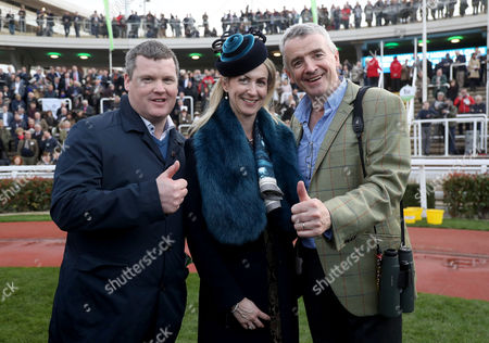 JT McNamara National Hunt Amateur Riders Steeplechase . Trainer Gordon Elliott , Michael O'Leary and wife Anita celebrate after Tiger Roll ridden by Lisa O'Neill wins the JT McNamara National Hunt amateur riders Steeplechase