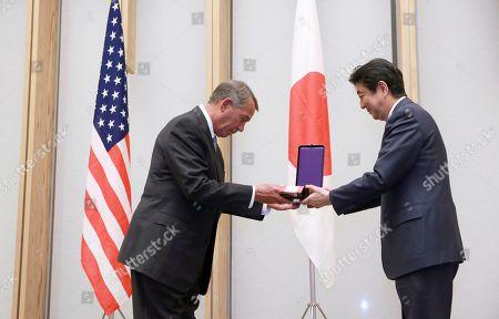 John Boehner, Shinzo Abe Former U.S. House Speaker John Boehner, left, is handed over a decoration medal from Japanese Prime Minister Shinzo Abe during the award ceremony at the prime minister's office in Tokyo