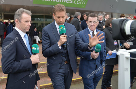 The ITV team of presenters in action on Day One of The Cheltenham Festival as they broadcast from here for the first time, L-R, Mick Fitzgerald, Ed Chamberlin and Sir Tony (A.P.) McCoy, former champion jump jockey, at Cheltenham Racecourse, before racing at The 2017 Cheltenham Festival.