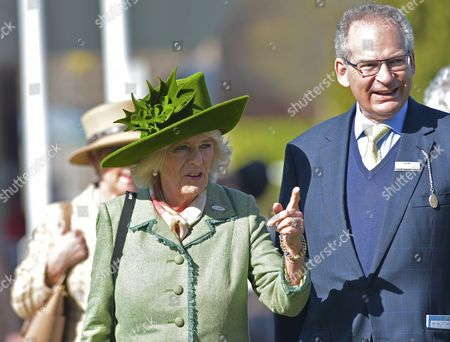 Camilla Duchess of Cornwall arrives with Robert Waley-Cohen, Chairman of Cheltenham on Ladies Day at The Cheltenham Festival.