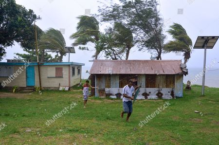 Fijian people run to get shelter during a Tropical Cyclone. On Feb 2016 Severe Tropical Cyclone Winston was the strongest tropical cyclone in Fiji in recorded history.