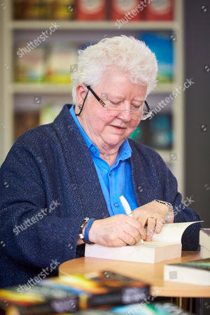 Val McDermid signing copies of her books.