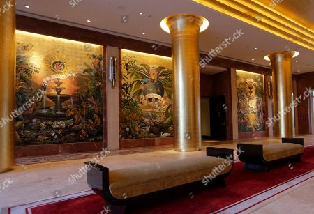 Gilded columns line the lobby adorned with murals by Argentinian painter Juan Gatti, known as the Cathedral, in the Faena Hotel in Miami Beach, Fla. The beachfront hotel is the flagship of Faena District, a cluster of buildings developed by Argentine hotel magnate Alan Faena where decaying structures and empty parking lots are giving way to opulent hotels, condos, and a performing arts center