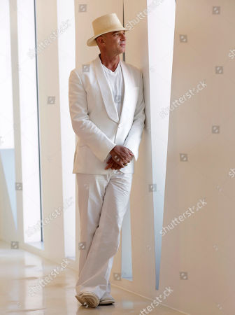 Argentine hotel magnate Alan Faena poses for a photograph in the Faena Forum, a performance and cultural center in the Faena District in Miami Beach, Fla. The center is part of a cluster of buildings developed by Faena, where decaying structures and empty parking lots are giving way to opulent hotels, condos, and a performing arts center