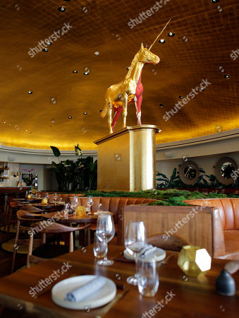 A unicorn sculpture by artist Damien Hirst is displayed in the Pao by Paul Qui restaurant in the Faena Hotel in Miami Beach, Fla. The beachfront hotel is the flagship of Faena District, a cluster of buildings developed by Argentine hotel magnate Alan Faena where decaying structures and empty parking lots are giving way to opulent hotels, condos, and a performing arts center