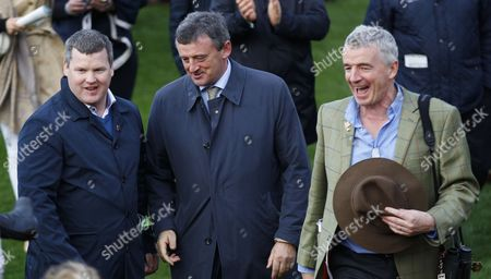 Gordon Elliott with Eddie O'Leary and Michael O'Leary [right] after Tiger Roll had won the JT McNamara National Hunt Challenge Cup Chase with Tiger Roll at Cheltenham.