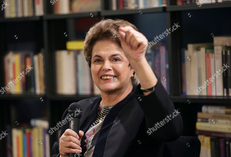 Former Brazilian President Dilma Rousseff gestures during a meeting with journalists at the Jose Saramago foundation in Lisbon . Rousseff is in Lisbon to participate in a conference on Wednesday