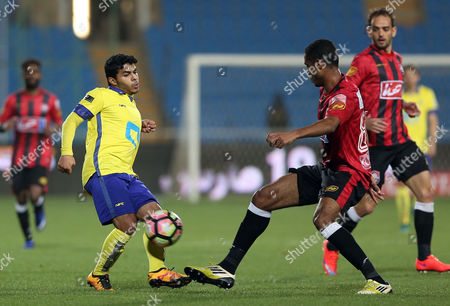 Al-Nassr player Yahya Al-Shehri (L) in action for the ball with Al-Raed player Daniel Amora (R) during the Saudi Arabia Professional League soccer match between Al-Raed and Al-Nassr at King Abdullah Sport City Stadium, Buraidah, Saudi Arabia, 14 March 2017.