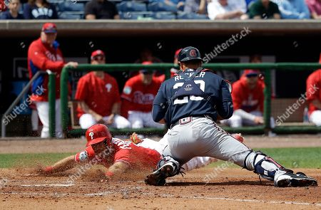 Taylor Featherston, Anthony Recker Philadelphia Phillies' Taylor Featherston, left, slides past Atlanta Braves catcher Anthony Recker to score a run in the fifth inning in a spring training baseball game, in Clearwater, Fla