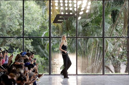 Brazilian model Caroline Trentini wears a creation from the Ellus collection during the Sao Paulo Fashion Week in Sao Paulo, Brazil