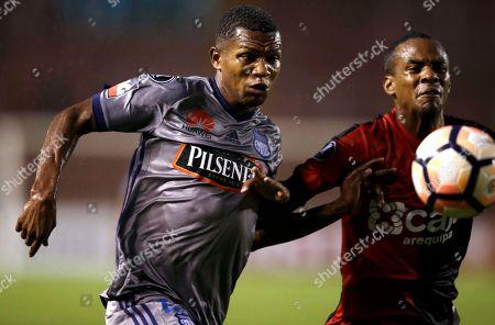 Romario Caicedo, Nilson Loyola Romario Caicedo, left, of Ecuador's Emelec, fights for the ball with Nilson Loyola of Peru's Melgar, during a Copa Libertadores soccer match in Arequipa, Peru