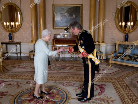 Queen Elizabeth II shakes hands with His Excellency the Ambassador of Spain Carlos Bastarreche, during a private audience at Buckingham Palace, London