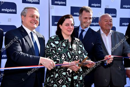 Emmanuelle Cosse (2-L), the French Minister for Housing and sustainable Habitat, Bernard Brochand (R), French Deputy and Paul Zilk (L), CEO of Reed Midem
