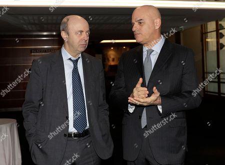 Eni CEO Claudio Descalzi, right, talks with Borsa Italiana s.p.a. CEO Raffaele Jerusalmi prior to the Eni investor meeting, in Milan, Italy