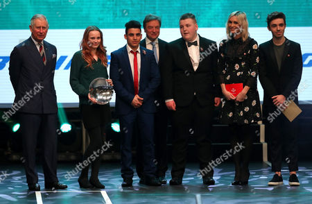 Prince Charles (L) on stage with the winner of the Boeing Educational Achiever of the Year award Caitlin Buckley (second left) and runners up Baseer Khan Omarkhil (third left) and Alfie Walters (third right) with Jenni Falconer (second right) and guests during the Prince's Trust Celebrate Success Awards