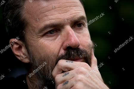 Spanish singer Pau Dones, his fingers tattooed with the name of his daughter Sara, reflects during an interview in Mexico City, . Despite the return of his colon cancer, Dones will perform at Vive Latino on Saturday with his band Jarabe de Palo