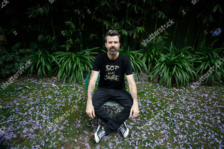 Spanish singer Pau Dones poses for a picture following an interview in Mexico City, . Despite the return of his colon cancer, Dones will perform at Vive Latino on Saturday with his band Jarabe de Palo