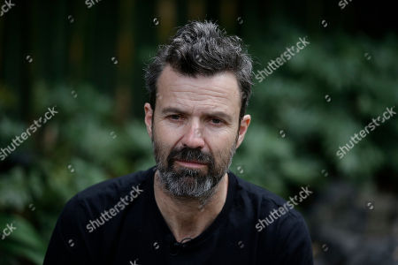 Spanish singer Pau Dones pauses during an interview in Mexico City, . Despite the return of his colon cancer, Dones will perform at Vive Latino on Saturday with his band Jarabe de Palo