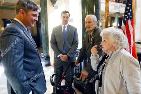 """Stock Picture of James """"Jake"""" Sanford, Joey Fillingane, Shirley Sanford, Noah Sanford Shirley Sanford, right, tells a story to Senator Joey Fillingane, R-Sumrall, left, as her husband Korean War veteran James """"Jake"""" Sanford, 81, second from right, and Rep. Noah Sanford, R-Collins, laugh outside House Chambers at the Capitol in Jackson, Miss., . Sanford was honored with a House concurrent resolution for his work with veterans, Wednesday, March 15, 2017, at the Capitol in Jackson, Miss"""