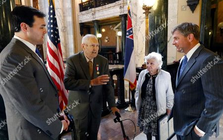 """Stock Photo of James """"Jake"""" Sanford, Joey Fillingane, Shirley Sanford, Noah Sanford Korean War veteran James """"Jake"""" Sanford, 81, second from left, confers with distant relative Rep. Noah Sanford, R-Collins, left, and Senator Joey Fillingane, R-Sumrall, right as his wife Shirley Sanford listens while standing outside House Chambers at the Capitol in Jackson, Miss., . Sanford was honored with a House concurrent resolution for his work with veterans, Wednesday, March 15, 2017, at the Capitol in Jackson, Miss"""