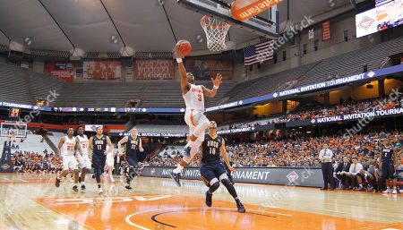 Syracuse's Andrew White III shoots during the first half of an NCAA college basketball game against UNC Greensboro in the NIT in Syracuse, N.Y., . Syracuse won 90-77