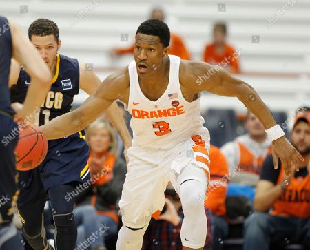 Syracuse's Andrew White III dribbles down court in the second half of an NCAA college basketball NIT game against UNC Greensboro in Syracuse, N.Y., . Syracuse won 90-77