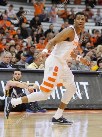 Syracuse's Andrew White III runs down court in the second half of an NCAA college basketball NIT game against UNC Greensboro in Syracuse, N.Y., . Syracuse won 90-77