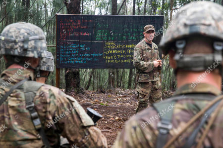 Instructor Staff Sgt. Shaun Thompson teaches soldiers from the U.S. Army's 25th Infantry Division 1st Stryker Brigade Combat Team during jungle warfare training at Schofield Barracks, Hawaii. The Army has set up a jungle training course amid a renewed focus on Asia and the Pacific after more than a decade of war in Iraq and Afghanistan