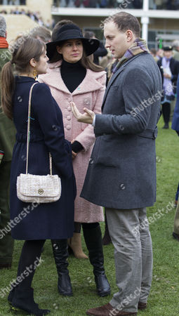 Stock Image of (L to R) Annabel Ballin, Sophie Winkleman and Lord Frederick Windsor at the St.Patrick's Thursday meeting at Cheltenham.