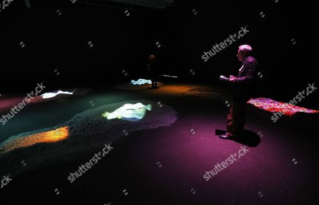 A man looks at the installation 'Remake of the Weekend' by artist Pipilotti Rist and part of the exhibition 'moving is in every direction. Environments ? Installations ? Narrative Spaces', in Berlin, Germany, 16 March 2017. The exhibition traces the history of installation art from the 1960s until today with a focus on narrative structures. The visitor explores expansive walk-in environments, video and sound installations, as well as cross-media works especially developed for the occasion. The exhibition is open to the public from 17 March to 17 September 2017.