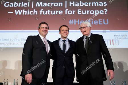 Former French Economy Minister and candidate for the next presidential election Emmanuel Macron, center, German Foreign Minister Sigmar Gabriel, left, and philosopher Juergen Habermas, right, arrive for an event of the Hertie School of Governance to discuss Europe's future in Berlin, Germany