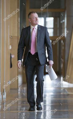 Tavish Scott makes his way to the Debating Chamber