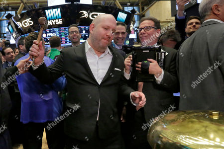 Canada Goose CEO & President Dani Reiss rings a ceremonial bell as his company's IPO begins trading on the floor of the New York Stock Exchange