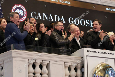 Canada Goose CEO & President Dani Reiss, second from right, is applauded as he rings the New York Stock Exchange opening bell to mark his company's IPO