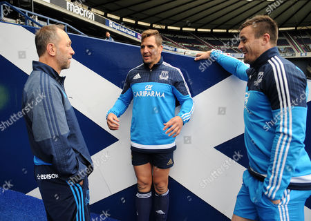 (L to R) Brendan Venter - Italy defence coach and Italy locks Andries van Schalkwyk and Abraham Steyn talk Afrikaans to each other in the Murrayfield tunnell.
