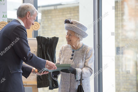 Stock Picture of General Sir Richard Shirreff (Chaiman) presenting Queen Elizabeth II Elizabeth II with a book