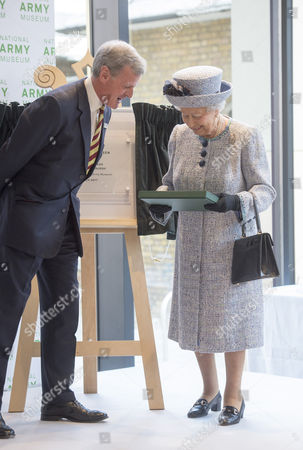 General Sir Richard Shirreff (Chaiman) presenting Queen Elizabeth II Elizabeth II with a book