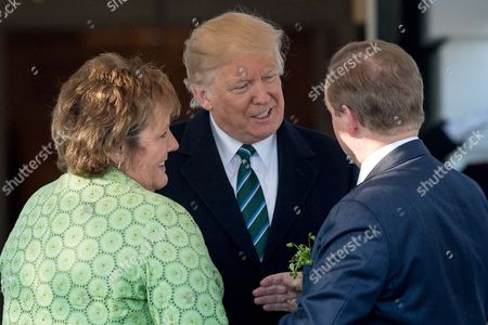 Stock Picture of Donald Trump, Enda Kenny, Fionnuala Kenny President Donald Trump greets Irish Prime Minister Enda Kenny, right, and his wife Fionnuala Kenny, left, on the South Lawn of the White House, in Washington