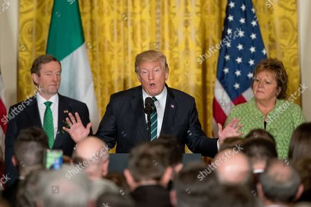 Donald Trump, Enda Kenny, Fionnuala Kenny President Donald Trump, accompanied by Irish Prime Minister Enda Kenny, left, and his wife, Fionnuala Kenny, right, speaks during a St. Patrick's Day reception in the East Room of the White House in Washington