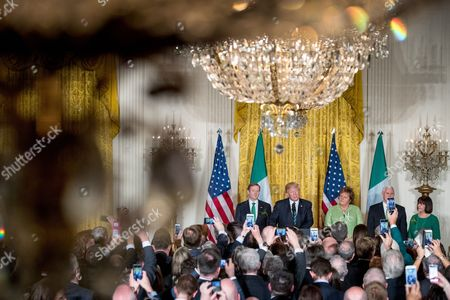Donald Trump, Enda Kenny, Finnuala Kenny, Mike Pence, Karen Pence President Donald Trump speaks during a St. Patrick's Day reception in the East Room of the White House in Washington, as Irish Prime Minister Enda Kenny, left, his wife, Fionnuala Kenny, third from right, and Vice President Mike Pence and his wife Karen listen