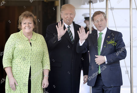 Stock Picture of United States President Donald Trump welcomes Prime Minister (Taoiseach) Enda Kenny of Ireland and his wife Fionnuala O'Kelly on the South Portico of the White House in Washington, DC in Washington, DC.