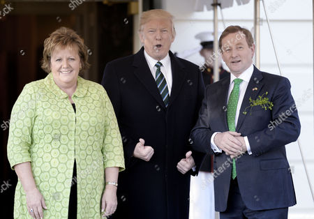 Stock Image of United States President Donald Trump welcomes Prime Minister Enda Kenny of Ireland and his wife Fionnuala O'Kelly on the South Portico of the White House in Washington, DC in Washington, DC.